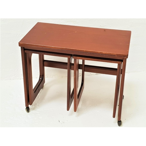 464 - MCINTOSH TEAK OCCASIONAL TABLE with an oblong fold over rotating top above two pull out occasional t...
