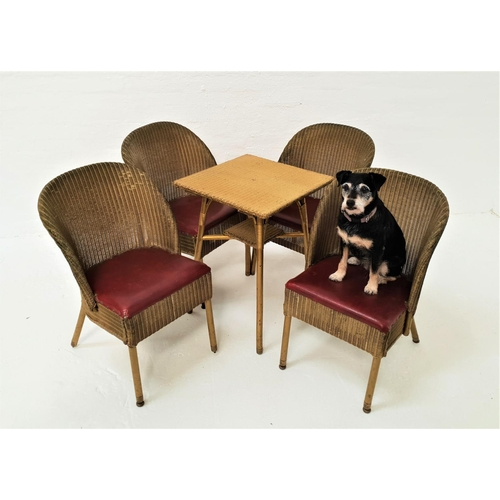 466 - LLOYD LOOM STYLE TABLE AND CHAIRS the table with a gold painted woven cane top, standing on turned s...
