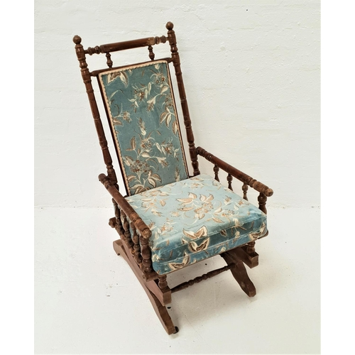 470 - EDWARDIAN ROCKING CHAIR with ring turned decoration and a padded back with matching seat cushion, on...
