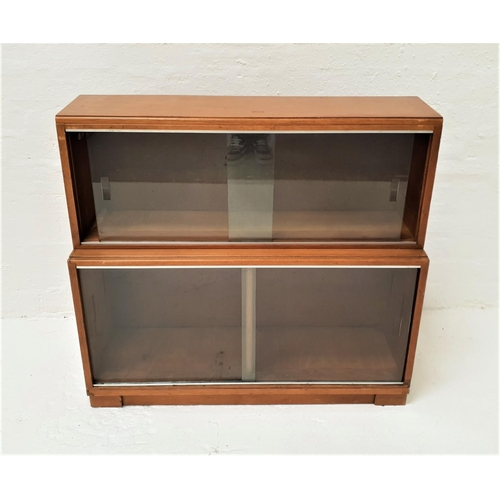 471 - MINTY TEAK BOOKCASE with a moulded top above a pair of glass sliding doors above another pair of gla...