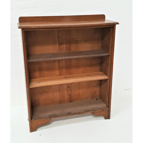 474 - OAK BOOKCASE with a shaped and raised back above a moulded top with three adjustable shelves below, ...