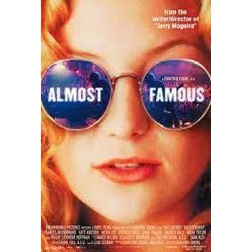 27 - ALMOST FAMOUS (2000) - TWO T-SHIRTS comprising a YELLOW 'LION TSAVO' KENYA T-SHIRT, the yellow t-shi...