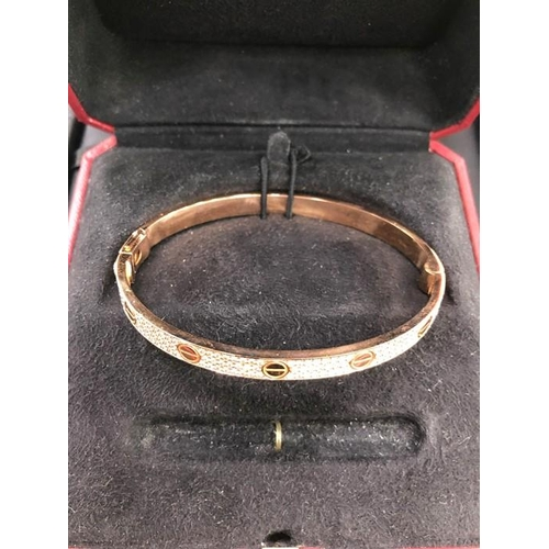 60 - A Rare Cartier Style Love Bracelet Set on rose Rose Gold & Diamond Set Size 20, which is believed to...