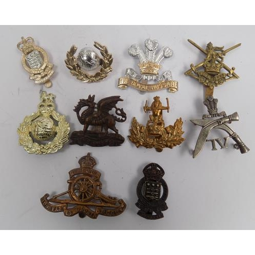 18 - Ten vintage military cap badges...