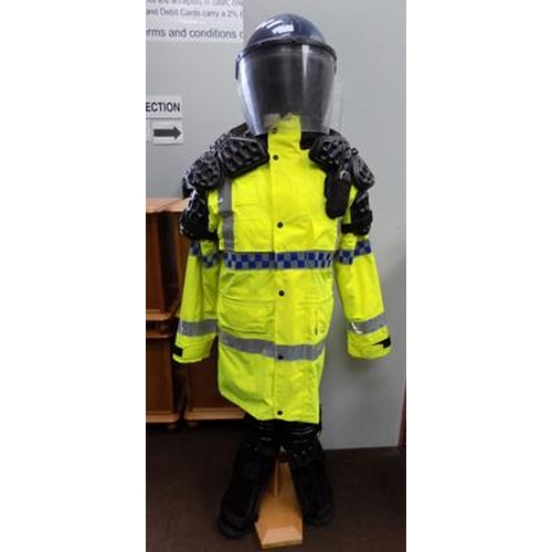 1 - A selection of Police style riot gear; including walkie talkie - (stand not included)...