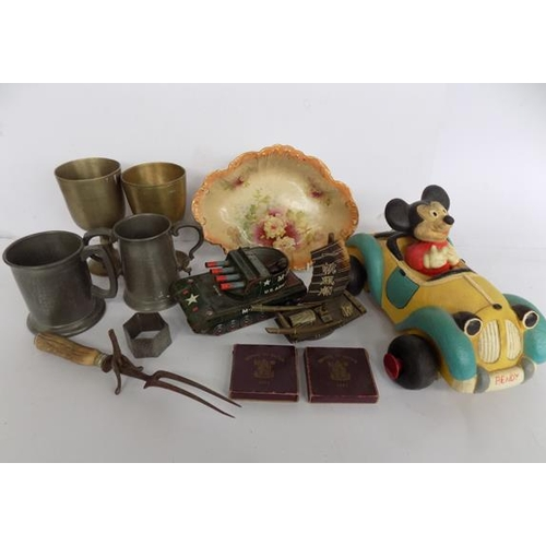 57 - A selection of mixed items; including coins, brass goblets and toys...