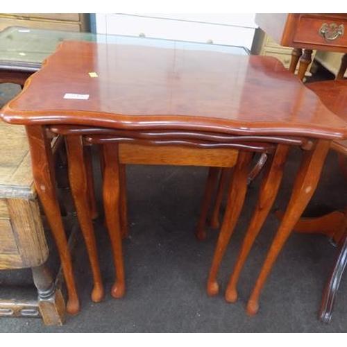 515 - Veneered nest of tables...