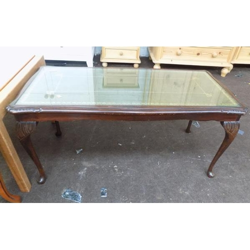 512 - Glass topped coffee table...