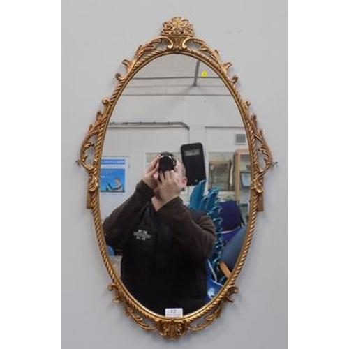 12 - Oval gilt framed mirror...