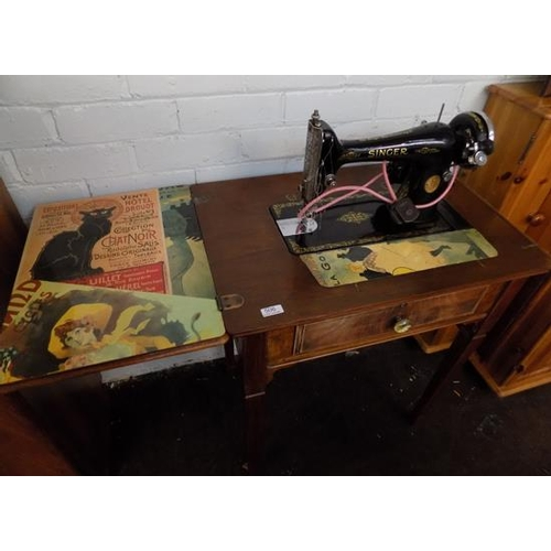 506 - Singer sewing machine in cabinet...