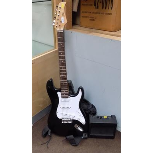 24a - Electric guitar, amp, stand & case...