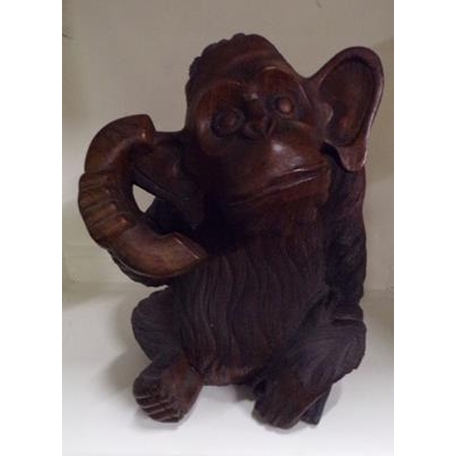 45 - 15 inches, carved chimp on phone...