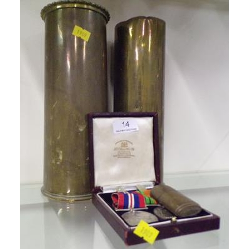 14 - Two brass shell casings 1910 + 1917 & Home Defence medals 1945...