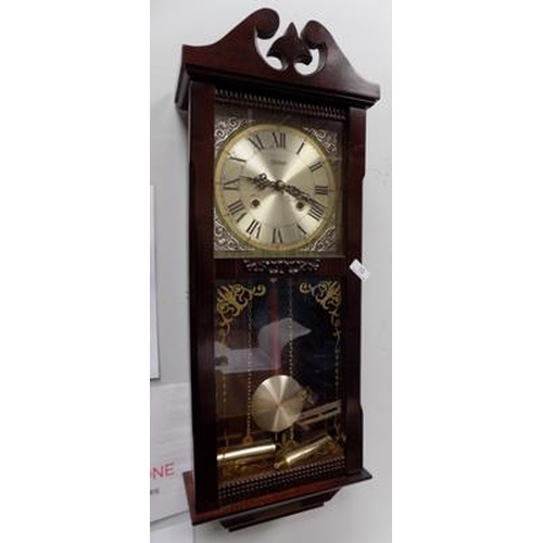 10 - Highlands wall clock, decorated with nouveau white metal corners. With key and pendulum...