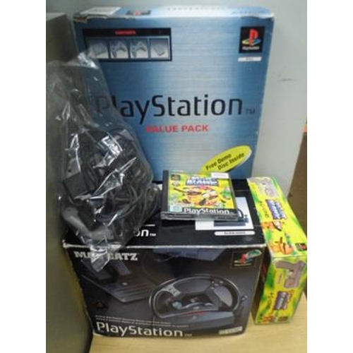 489a - Playstation console & accessories - all in working order...