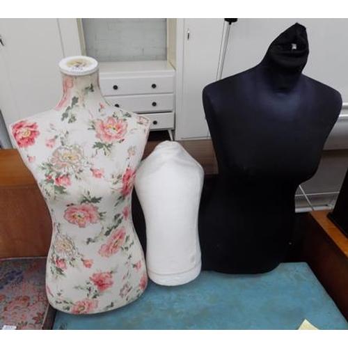 517a - Three mannequin torsos...