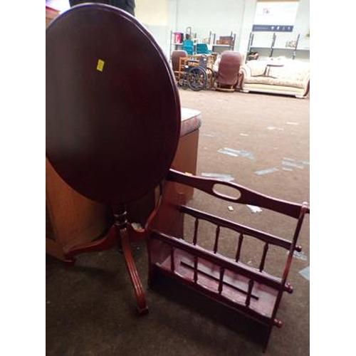 519 - Mahogany folding table & magazine rack...
