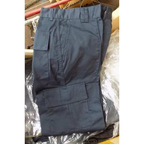 485a - Box of Uneek navy work trousers, various sizes...