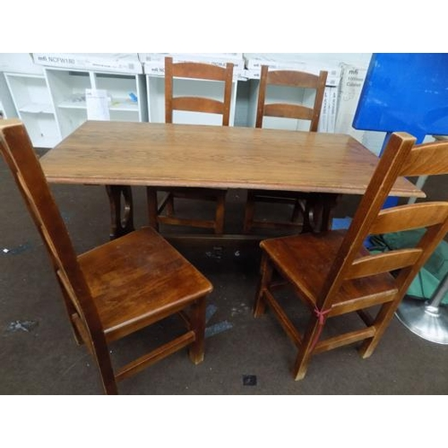 514 - Solid oak table and 4 chairs...