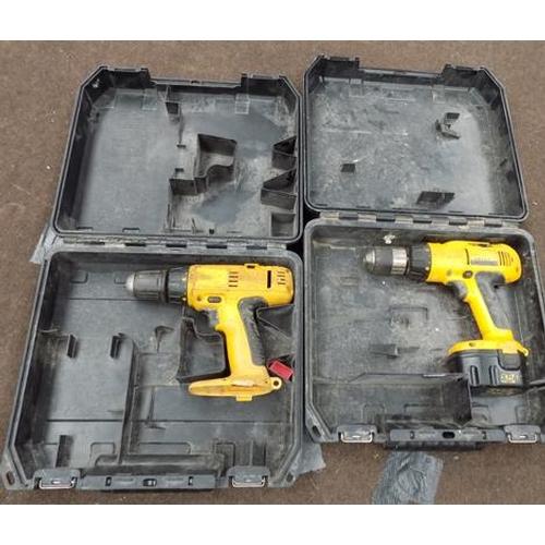 496 - Two Dewalt 18v drills in cases, no batteries or charger...