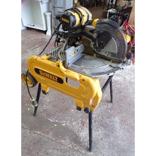 492 - Dewalt volt table saw on legs, W/O with nearly new saw blade - just fitted...