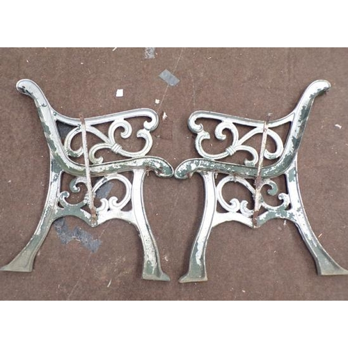 497 - Pair of cast iron bench ends...