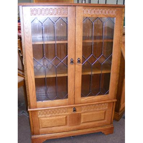518 - Oak glass fronted, two door cabinet...