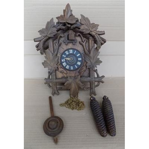 10 - Vintage cuckoo clock, with brass weights and mechanism - not battery...