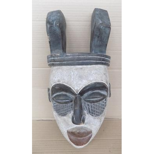 11 - African tribal mask, wooden with large horns...