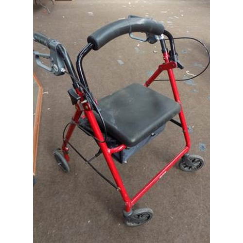 534 - Four wheeled mobility walker with brakes...