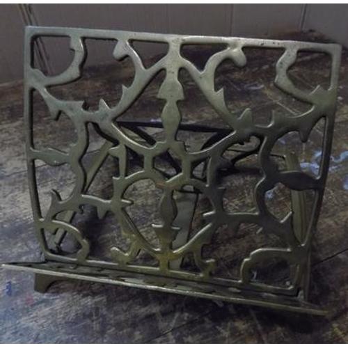 19 - Brass book holder & religious books...