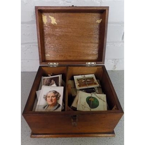 47 - Wooden chest of cigarette & postcards, incl. Gallagher, Ogden, Player, Carreras, Kensitas...