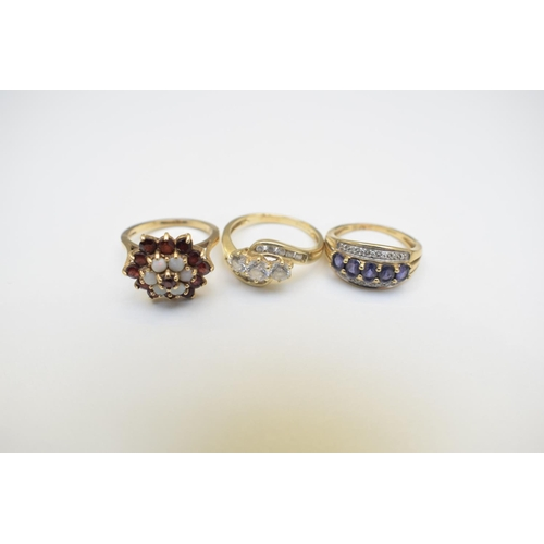 36 - 9ct Hallmarked Dress Rings - Two 14ct Hallmarked Cubic Zirconia Crossover Ring. Total Weight 10.10g...