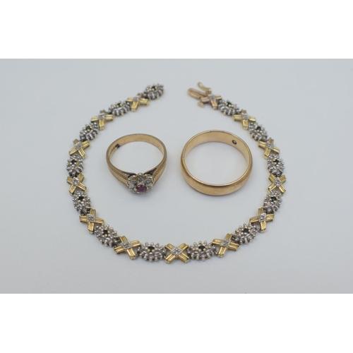 4 - 9ct Hallmarked Ruby and Illusion Kiss Style  9ct Hallmarked Diamond Set Wedding Ring. Total Weight 1...