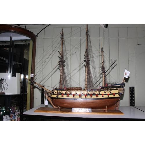 57 - Carved wood galleon depicting Nuestra Senora, 110cm length.