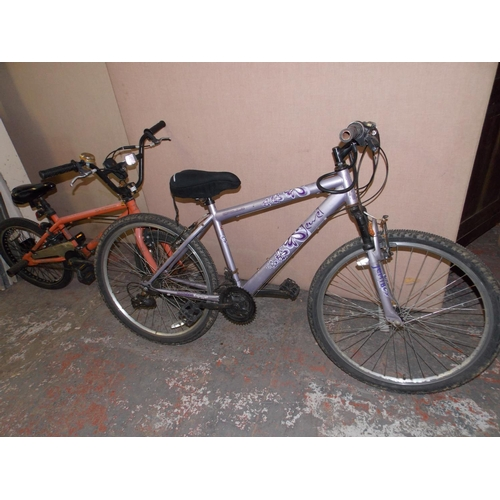 10 - TWO BIKES - A PURPLE APOLLO DUAL GIRLS MOUNTAIN BIKE WITH FRONT SUSPENSION AND 21 SPEED SHIMANO GEAR...