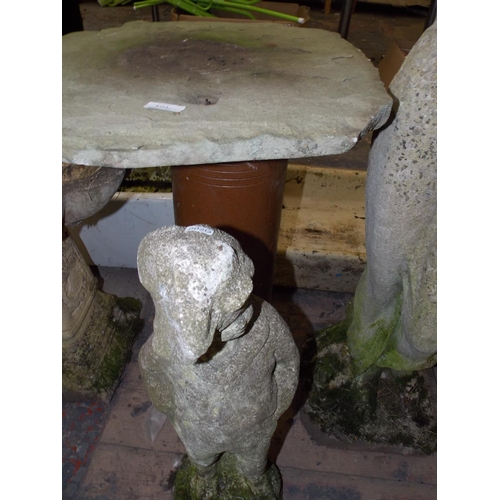 101 - TWO ITEMS - A STONE TOPPED BIRD TABLE AND A SMALL BOY CONCRETE GARDEN ORNAMENT...
