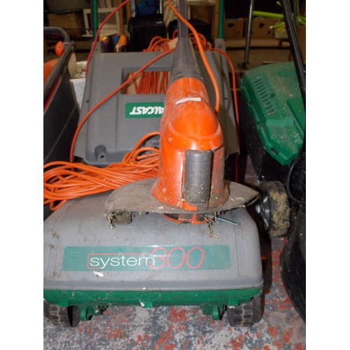 105 - TWO ITEMS - A GREEN QUALCAST SYSTEM 300M ELECTRIC LAWN MOWER AND A FLYMO MULTI TRIM 250 ELECTRIC STR...