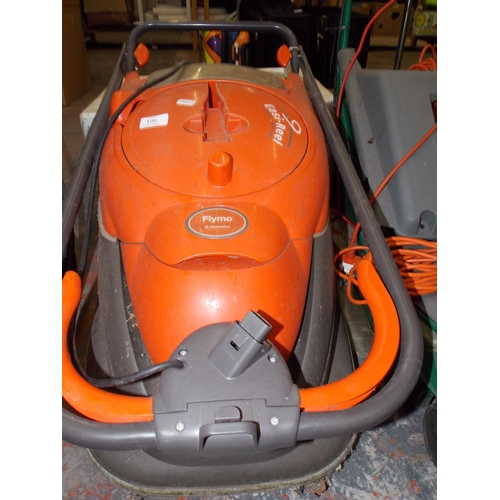 106 - AN ORANGE FLYMO ELECTRIC HOVER MOWER WITH EASY REEL CABLE...