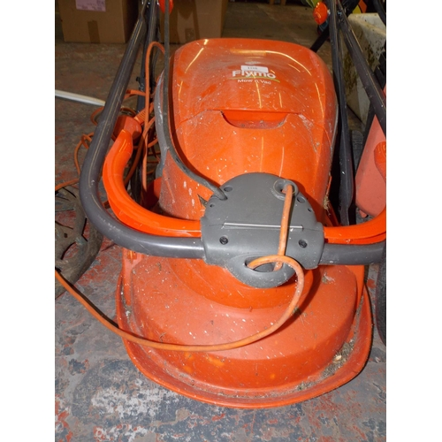 108 - AN ORANGE FLYMO ELECTRIC LAWN MOWER...