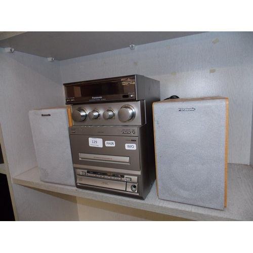 129 - A SILVER PANASONIC STEREO SYSTEM WITH TAPE, CD, AND RADIO WITH TWO MATCHING SPEAKERS W/O...