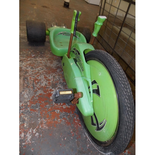 13 - A GREEN HUFFY GREEN MACHINE BOYS TRICYCLE WITH PULL LEVER STEERING...