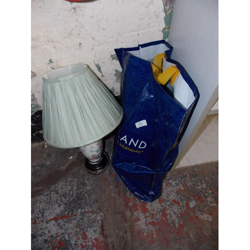 135 - TWO ITEMS - ORECK XL VACUUM CLEANER AND A PORCELAIN TABLE LAMP...