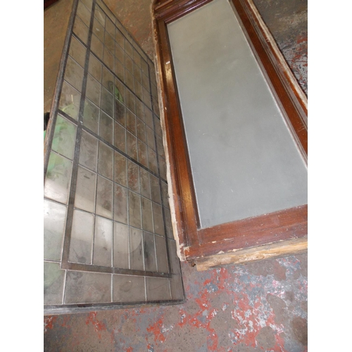 14 - THREE ITEMS - TWO WOODEN WINDOWS WITH CURVED TOP MEASURING APPROX 7 X 2 FT AND A LEADED GLASS WINDOW...
