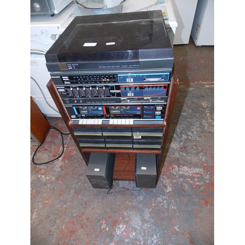 143 - A VINTAGE MURPHY STEREO SYSTEM - TWIN TAPE DECK, GRAPHIC, RADIO ETC TWO MATCHING SPEAKERS IN A CABIN...