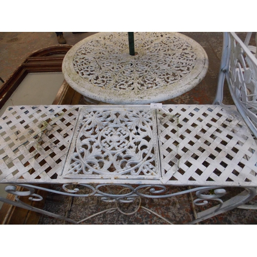 15 - THREE ITEMS - A CIRCULAR CAST ALUMINIUM ORNATE GARDEN TABLE WITH PARASOL AND A RECTANGULAR ORNATE WH...