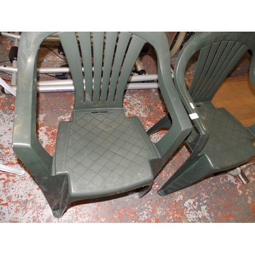 17 - TWO GREEN STACKABLE CHAIRS AND BAGGED WILLIAMS CAR CLEANING KIT...