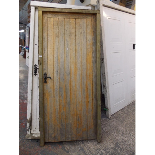 23 - TWO WOODEN EXTERIOR DOORS AND FRAMES MEASURING APPROX 6.8 FT X 3 EACH (KEYS IN OFFICE)...