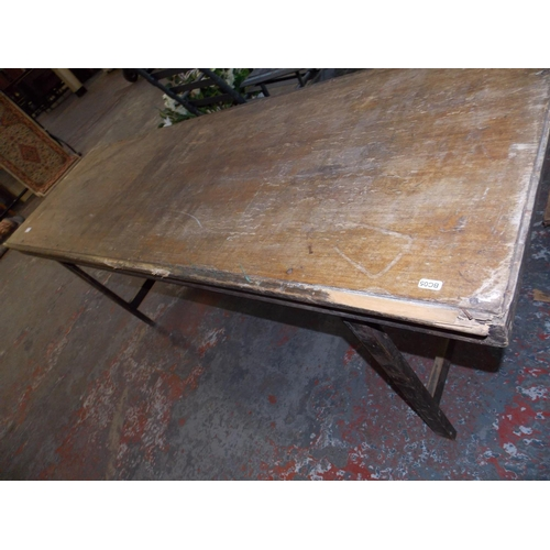 24 - A VINTAGE WOODEN TRESTLE TABLE MEASURING APPROX 6 X 2FT...