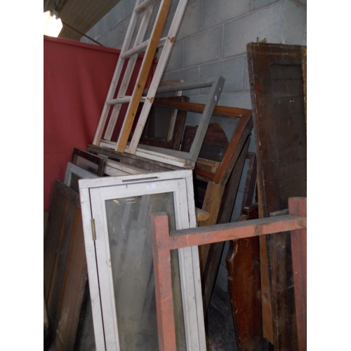 27 - A VERY LARGE SELECTION OF WOODEN WINDOWS, FRAMES AND WOOD PANELS...